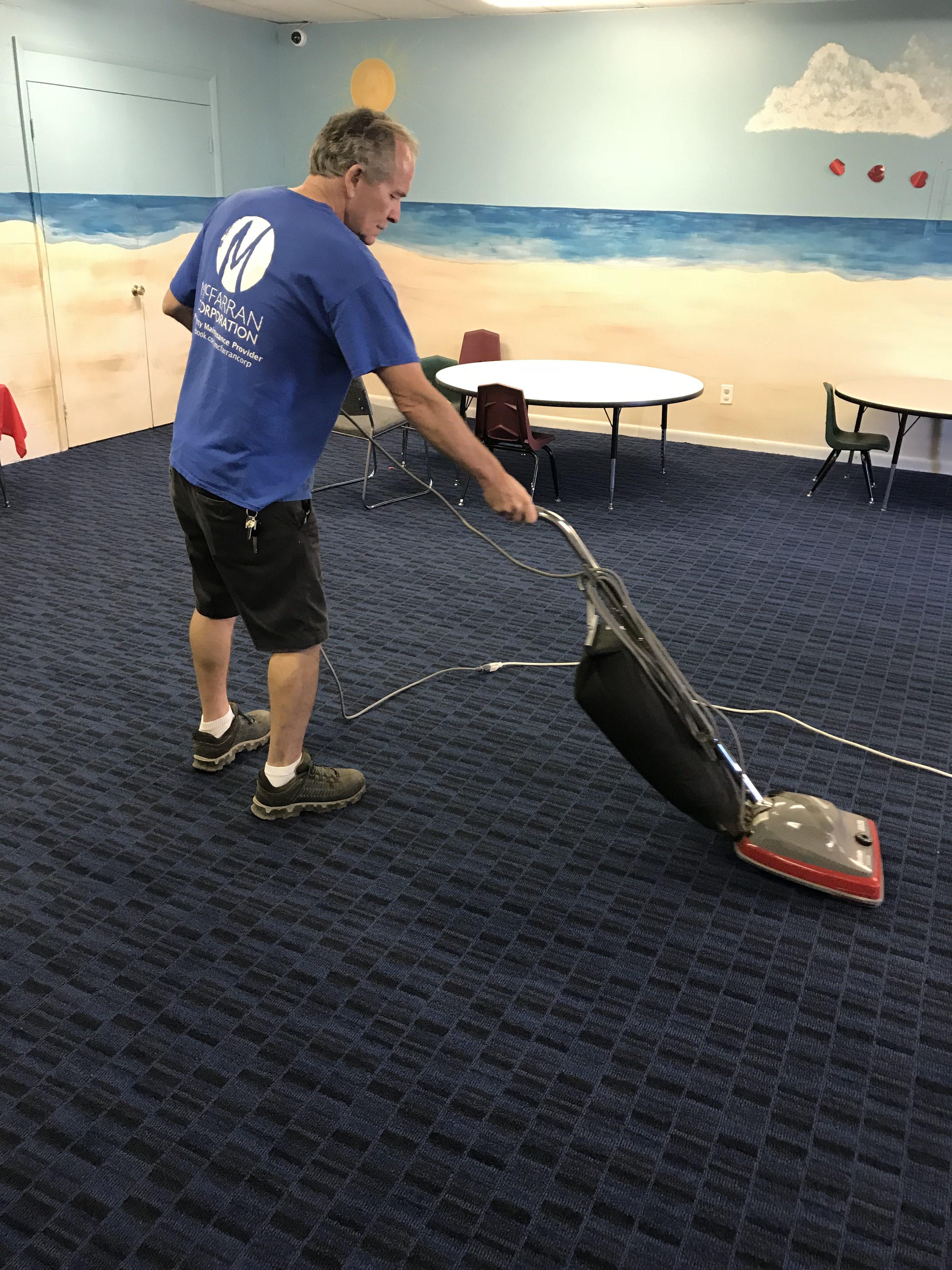 McFarran School Janitor Vacuuming Classroom Floor